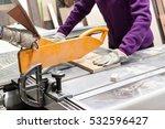 worker using saw machine to... | Shutterstock . vector #532596427