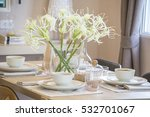 Small photo of able set on wood dinning table at home