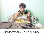 young man lies in bed sick with ... | Shutterstock . vector #532717327