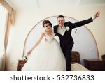 Young And Happy Bride And Groo...