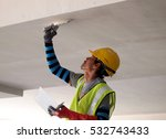 Small photo of SELANGOR, MALAYSIA -SEPTEMBER 06, 2016: Construction site workers are doing concrete ceiling soffit skim coat work at the construction site. Two layers apply to get the smooth surface.