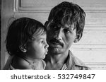 Small photo of A black and white image of a father with his daughter.Image taken at a heath camp organised by an NGO in Mumbai,India.Image date:17th Feb 2011