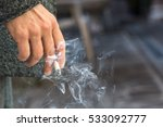 hand with burning cigarette | Shutterstock . vector #533092777