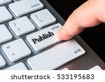 Small photo of Finger on computer keyboard keys with Publish word