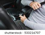 Closeup Of Man Fastening Seat...