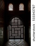 Small photo of Interior of Alhambra, Granada, Andalusia, Spain. Window with fishnet arabesques decoration.