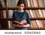 young girl reading a book. | Shutterstock . vector #533425063