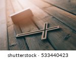 cross and bible on old wooden...