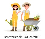 Stock vector couple of gardeners man with wheelbarrow of earth a woman holding a flower pot and watering can 533509813