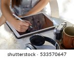 woman using tablet computer in