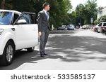 businessman standing near a car ... | Shutterstock . vector #533585137