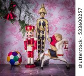 Small photo of Christmas ambiance and world of children. Wooden toys: nutcracker, clown, horse also teddy bear and ball.