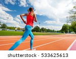 Athletic Woman Running On...