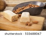 marzipan bar and almonds on... | Shutterstock . vector #533688067