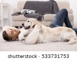 Handsome Man With Dog  Lying O...