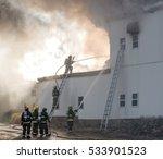 firemen fighting a fire. one... | Shutterstock . vector #533901523