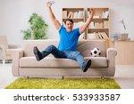 man watching football at home   Shutterstock . vector #533933587