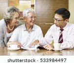 senior asian couple listening... | Shutterstock . vector #533984497