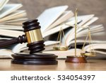 wooden gavel and books on... | Shutterstock . vector #534054397