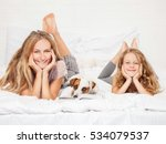 mother with child in bed.... | Shutterstock . vector #534079537