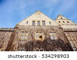 Small photo of POZNAN, POLAND - NOVEMBER 21, 2016: Plant growth on the Adama Mickiewicz University building in the city center