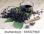 Glass Of Fresh Elderberry Syru...
