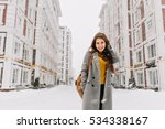 charming young woman in coat... | Shutterstock . vector #534338167