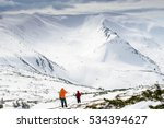 two hikers admiring the winter... | Shutterstock . vector #534394627