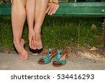 Small photo of Woman massaging aching feet