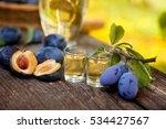 plums and shot glasses with... | Shutterstock . vector #534427567
