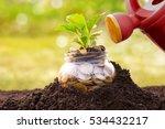 water can watering money jar | Shutterstock . vector #534432217