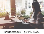 smiling woman sitting alone in... | Shutterstock . vector #534437623