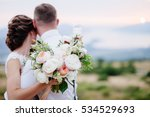 bride hold wedding bouquet of... | Shutterstock . vector #534529693