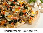 meat pizza with spinach on a... | Shutterstock . vector #534551797