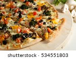 meat pizza with spinach on a... | Shutterstock . vector #534551803