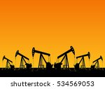 silhouette of working oil pumps ... | Shutterstock .eps vector #534569053