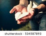 paper airplane in male hands... | Shutterstock . vector #534587893