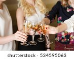 hands holding the glasses of... | Shutterstock . vector #534595063