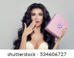 surprised woman with gift box.... | Shutterstock . vector #534606727