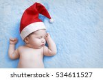 newborn baby in a christmas cap ... | Shutterstock . vector #534611527