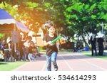 school boy is running during... | Shutterstock . vector #534614293