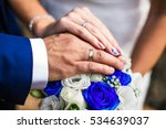 Newly Wed Couple's Hands With...