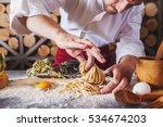 male chef making homemade pasta ... | Shutterstock . vector #534674203