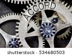 Small photo of Macro photo of tooth wheel mechanism with ACCORD concept letters
