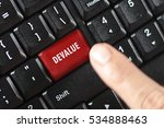 Small photo of devalue word on red keyboard button