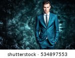 fashion shot of a handsome... | Shutterstock . vector #534897553