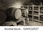 Barrels With A Wine In A Cella...