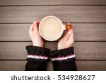 Little Girl Hand Holding Cup O...