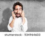 young funny man covering ears... | Shutterstock . vector #534964603