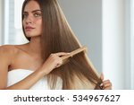 Brushing Hair. Portrait Of Sex...